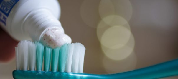 Toothpaste on a brush used to tell the story. [PHOTO CREDIT: Wikipedia]