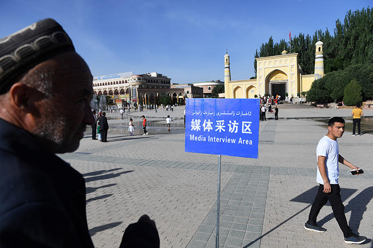 "This photo taken on June 5, 2019 shows a ""media interview area"" set up near the Idkah mosque on the morning of Eid al-Fitr, when Muslims around the world celebrate the end of Ramadan in Kashgar, in China's northwestern Xinjiang region. - On the morning of Eid al-Fitr, the enormous square outside of the main mosque in Kashgar was cordoned off, with reporters forced into a ""media interview area"" on the outer edges of the square as worshippers filed into the mosque -- whereas in previous years devotees gathered in crowds outside (Photo by GREG BAKER / AFP) / TO GO WITH China-Xinjiang-media-rights-press,FOCUS by Eva XIAO"