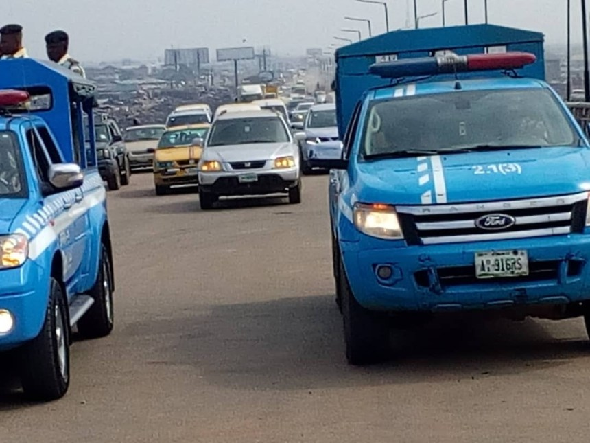 FRSC officials supervising the opening of the Kara Bridge on Lagos-Ibadan Expressway to traffic on Sunday in Lagos