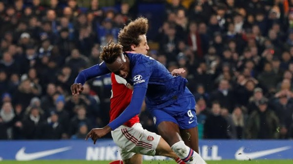 Arsenal's David Luiz tackles Chelsea's Tammy Abraham resulting in a RED Card and a penalty (Photo Credit: Reuters on Google)