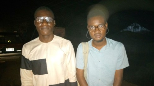 Premium Times' journaists, Alfred Olufemi and Adejumo Kabir after signing out of the police station