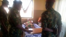A picture of army officers visiting the wounded at the hospital in the aftermath of the January 2 attack.
