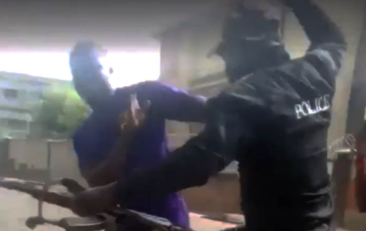 Police beating young Nigerian