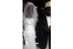 Shortlived. Sheikh Mohammed Mutumba with his 'bride' on their wedding in Kayunga District two weeks ago PHOTO BY FRED MUZAALE published in Daily Monitor
