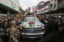 Thousands of Iraqis join the funeral procession for Iranian general Soleimani, killed in a US air strike on Friday. [PHOTO CREDIT: Aljazeera.com]