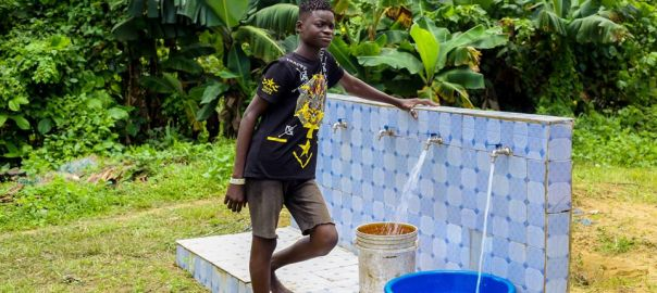 A boy in Edonwick, Eastern Obolo, Akwa Ibom state, fetches water from the borehole donated by Mary Remarkable Foundation
