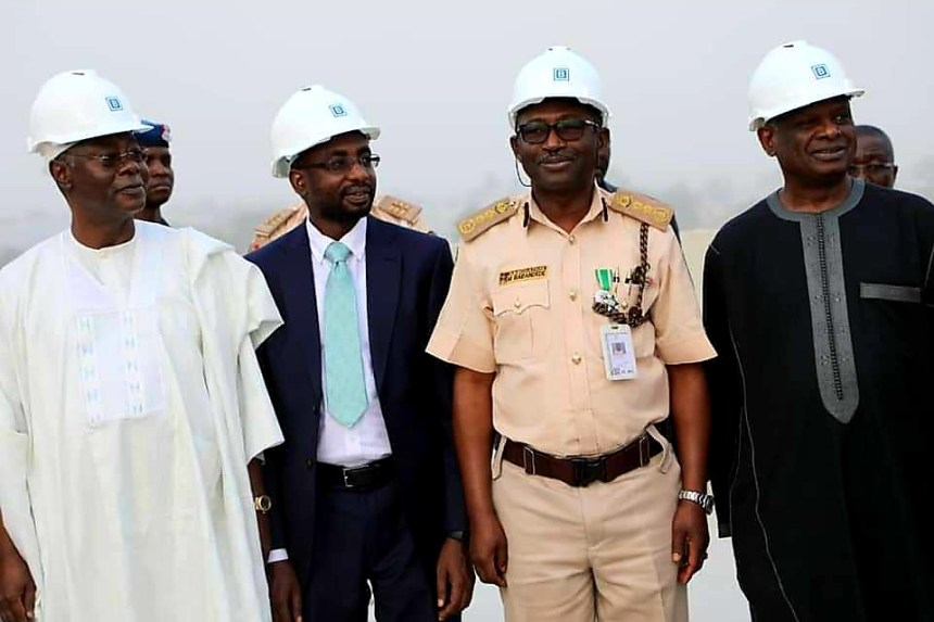 Director General, National Information Technology Development Agency (NITDA), Kashifu Abdullahi (second left) Comptroller General, Nigeria Immigration Service (NIS), Muhammed Babandede (second right) and other senior management from NITDA during Topping Up Ceremony of the NIS Technology Building in Abuja.
