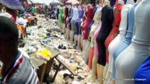 Traders amid dirt in Ngwa market