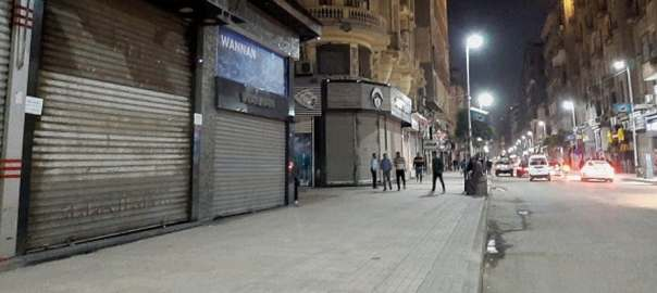 A deserted street in Cairo after the government ordered the closure of shops, restaurants and cafes.