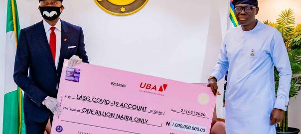 UBA Supports Lagos State in Fight Against COVID-19 . Group Managing Director/CEO, United Bank for Africa(UBA), Mr, Kennedy Uzoka presenting a cheque of N1 billion to Governor of Lagos State, Mr. Babajide Sanwo-Olu, as part of the Bank's donation of over 5 billion Naira (USD14 million), through the UBA Foundation, to catalyse a comprehensive pan-African response to the fight against the coronavirus (COVID-19) global pandemic., in Lagos House, Marina on Sunday
