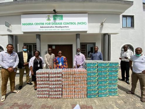 L-R: Director, Special Duties, DG's Office, Nigeria Centre for Disease Control, Abuja, Dr Priscilla Ibekwe receiving a donation of malt and soft drinks from the Head of Government Relations, Nigerian Breweries Plc, Vivian Ikem as part of the company's support in the fight against COVID-19.