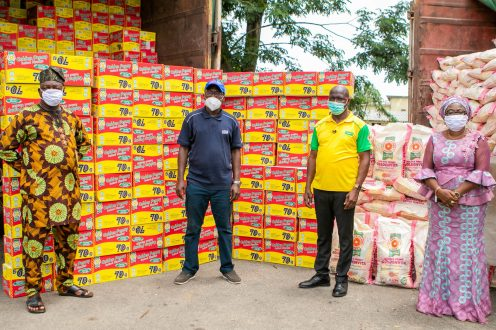 FMN officials handing over the donated food items