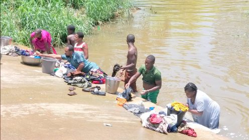 Some commnity people in Akwa Ibom doing their laundry at a local stream.