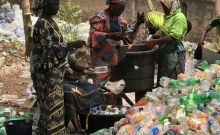 Women sorting through plastic waste at the Vicfold 'Recycling Park' located a stone's throw from the University of Ilorin waste dump site and landfill. Women play a major role in the Vicfold Recyclers plastic waste sourcing, collection and preparation system. Most of the women are unemployed and come from outside the university community. Photo: AllAfrica