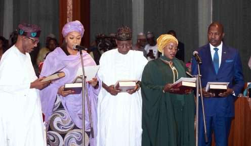 FILE PHOTO: In this photo released by the Nigeria State House, newly sworn in Cabinet Ministers from left, Minister of State Health Adeleke Mamora, Minister of State Transportation Gabemisola Saraki, Minister of information Lai Mohammed, Minister of State FCT Hajiya Ramatu Tijjani and Minister of Justice and Attorney General of the Federation Abubakar Malami during their swearing-in at the Council Chambers of the State House, in Abuja, Nigeria Wednesday, Aug. 21, 2019. (Sunday Aghaeze/Nigeria State House via AP)