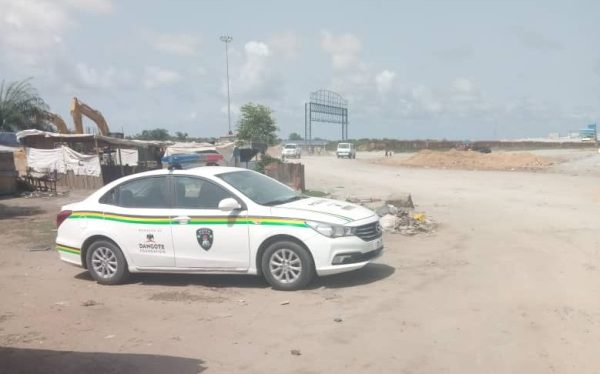 Police van stationed near the site