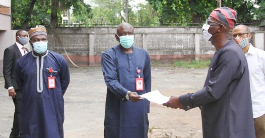 Sanwo-Olu, Lagos State governor (r) receiving the property documents from Rabo