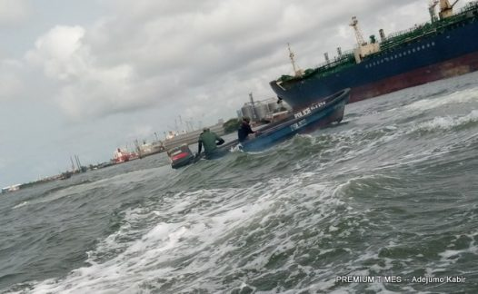 Two marine police officers on the sea after taking bribe from boatman