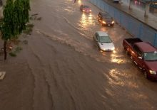 Ikeja Along: Lagos residents battle flood after heavy downpour [PHOTO CREDIT: Premium Times]