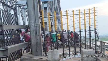 A gate with spikes erected by the Anambra State government at the Niger Bridge