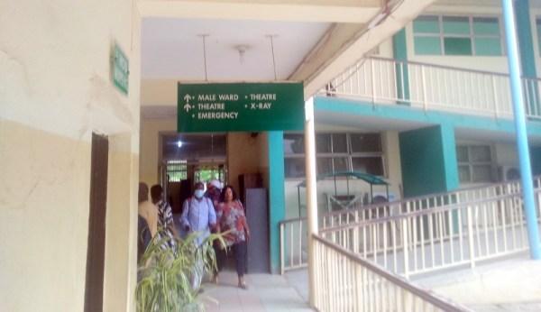 Hospital attendant at Wuse general hospital checking temperature of visitors. (PHOTO CREDIT: Ebuka Onyeji)