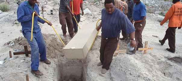 A victim of the Aids pandemic is buried in Cape Town in 2004. Kim Ludbrook/EPA