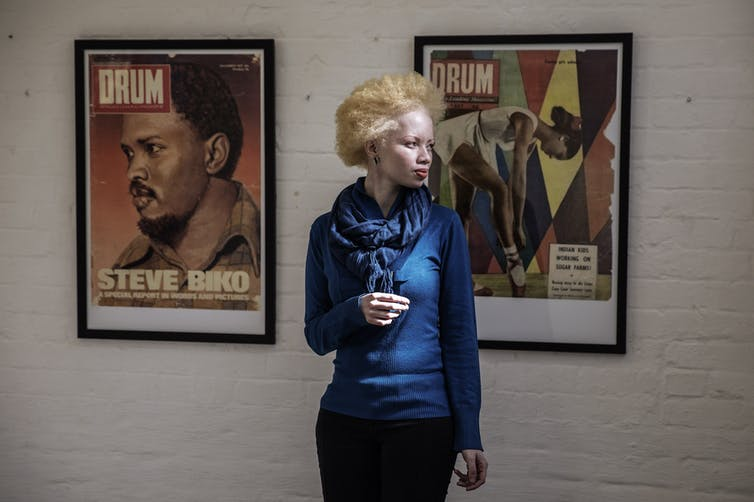 South African lawyer and part-time fashion model, Thando Hopa, at an exhibition of Drum magazine front pages in. Johannesburg. Gianluigi Gueracia/AFP via Getty Images