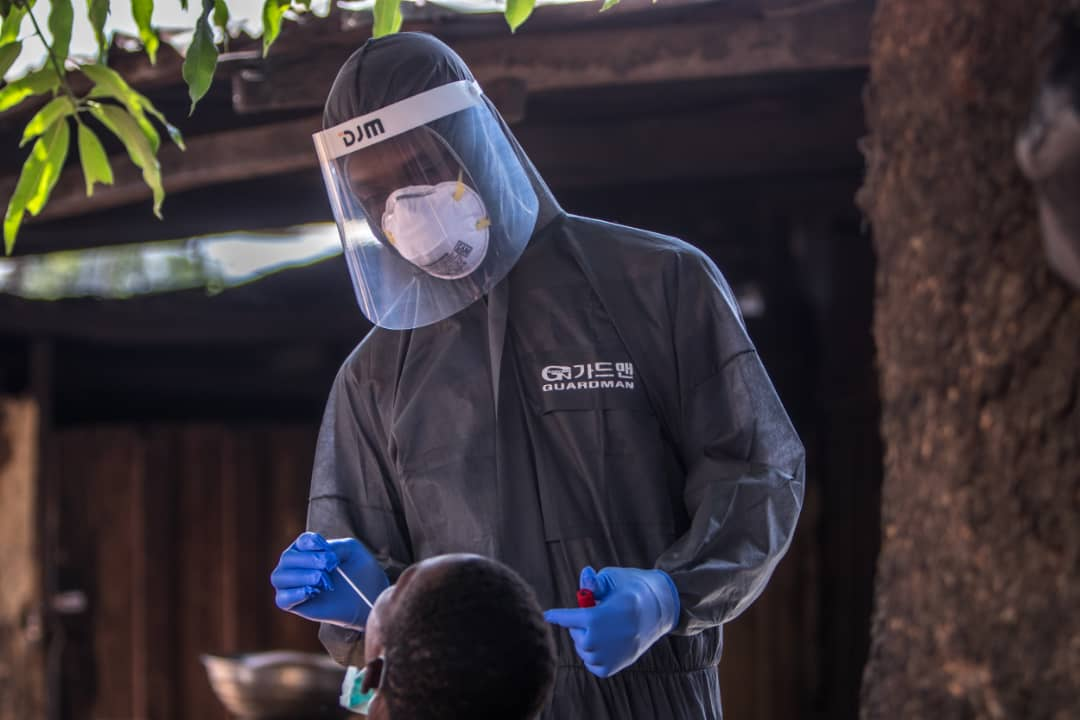 A man is being tested for COVID-19 in Nigeria [PHOTO: TW: @NCDCgov]
