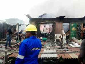 Officials assessing the burnt properties.