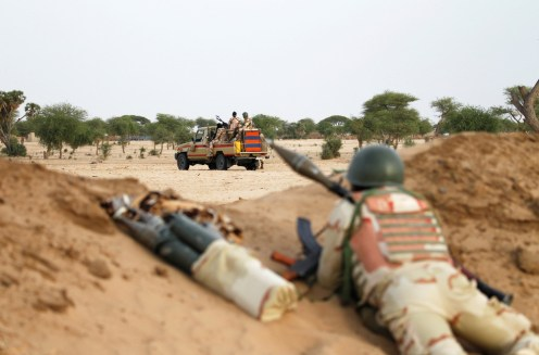 Niger soldiers with their weapons pointed towards the border with neighbouring Nigeria, near the town of Diffa, Niger. [Credit: Luc Gnago/Reuters]