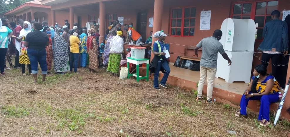 Voters applying hand sanitizers before accreditation at Iyamho Ward 10, PU 01. Etsako West LGA.