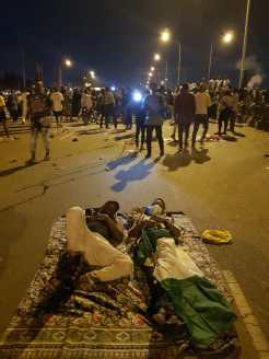 Protesters block traffic as they hunker down for the night, protesting against SARS