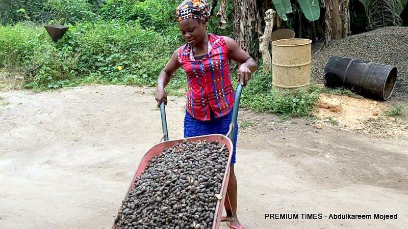 Ukamaka Peter with a wheelbarrow