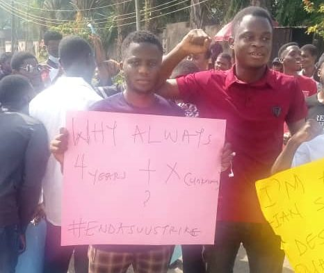 Protesting students with placards