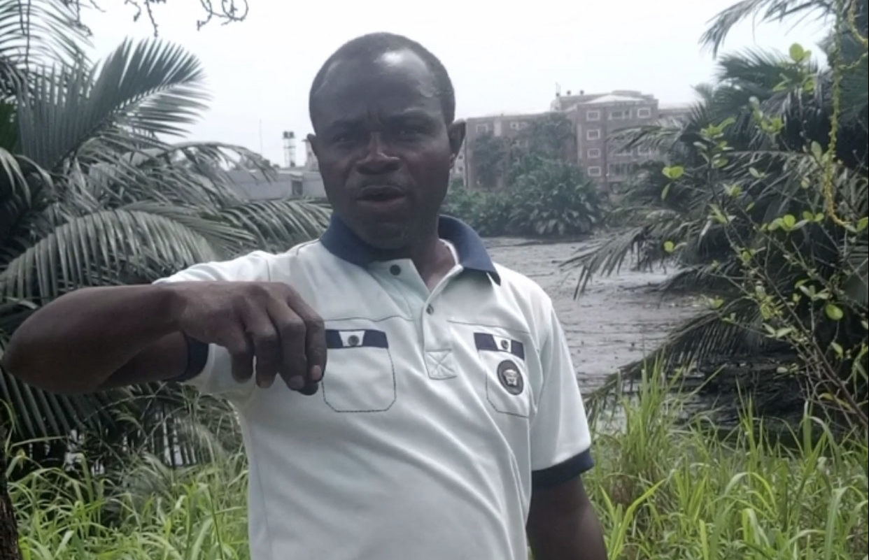 Oto Obasi, a small-scale gardener is standing at the bank of Nta Wogba stream. Photo Credit: Beloved John