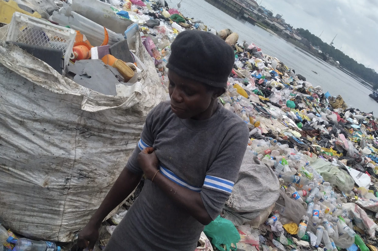 Mercy Samuel is a scavenger who ignorantly contributes to marine debris in Abuloma Jetty. Photo Credit: Beloved John