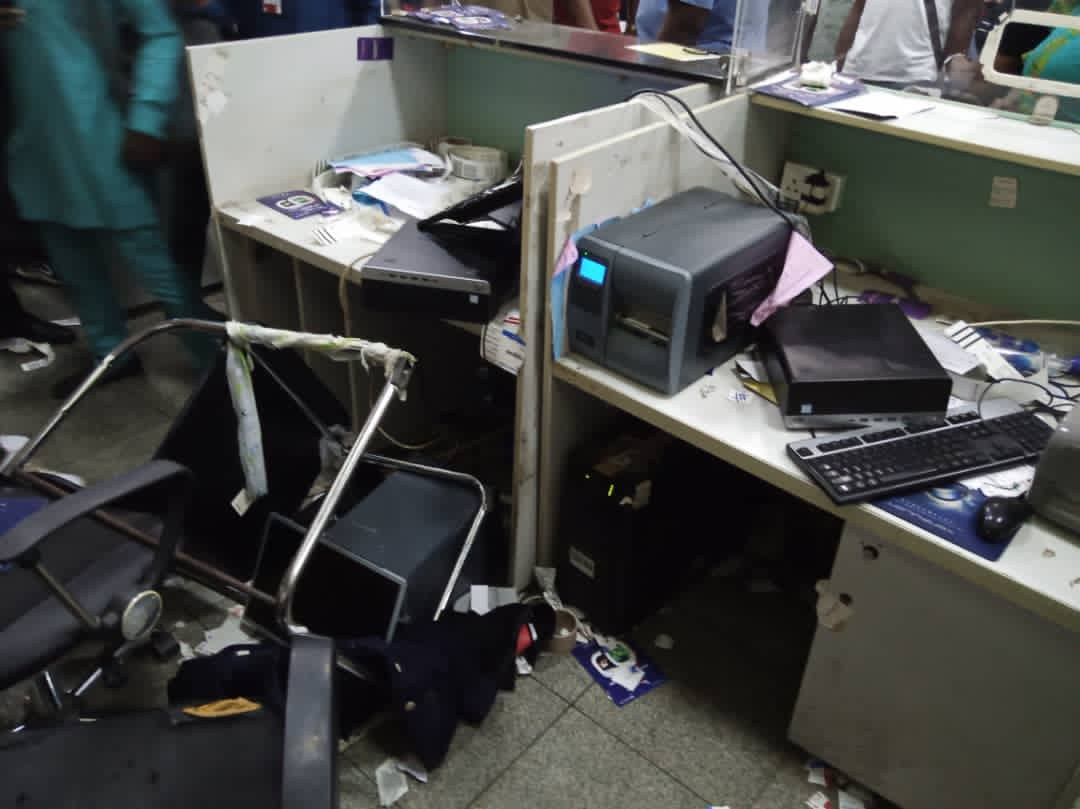 Passenger destroys Dana air check-in facilities in Abuja.