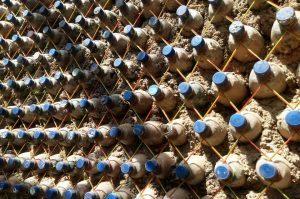 sand-filled plastic bottles used as bricks