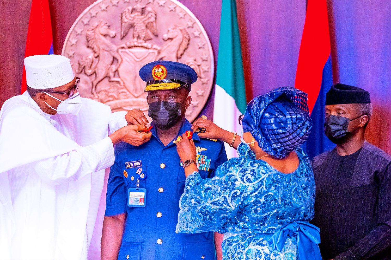 President Muhammadu Buhari decorating Isiaka Amao, the Chief of Air Staff, Isiaka Amao, as air marshal [PHOTO CREDIT: @BashirAhmaad]