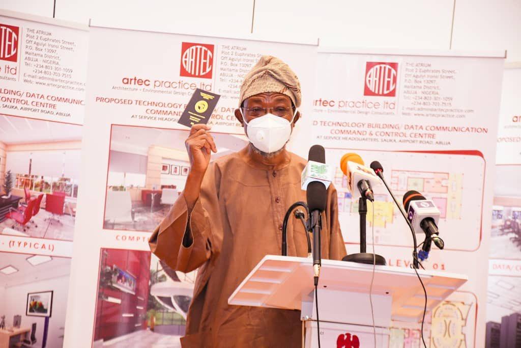 Rauf Aregbesola displaying the new ICAO-Complaint Nigerian Temporary Passport (NTP) [PHOTO CREDIT: @raufaregbesola]