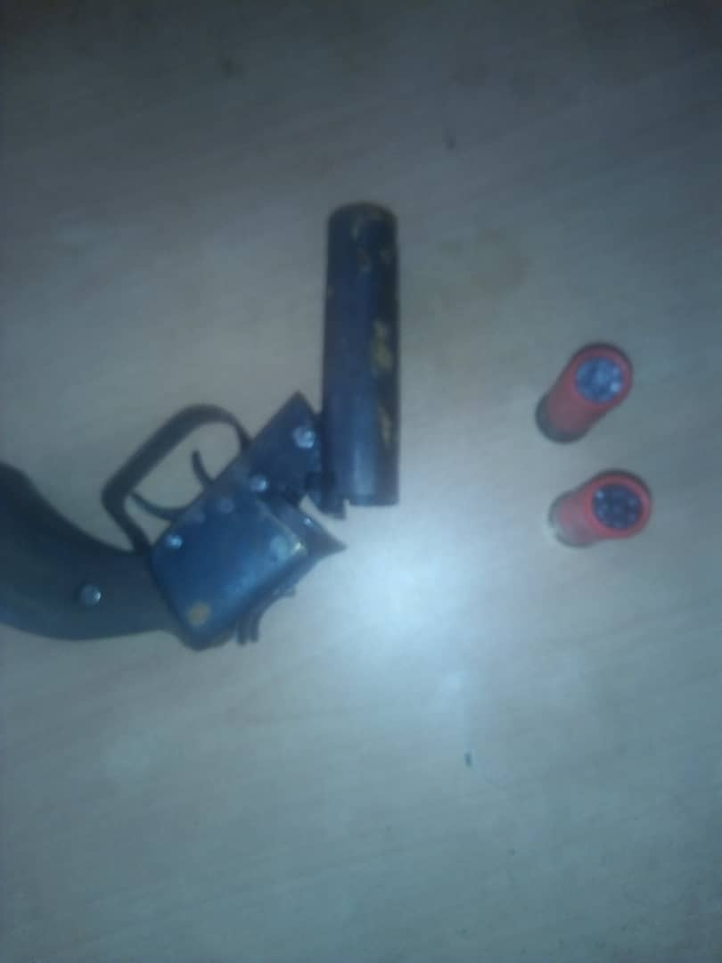 Locally-made pistol and live ammunition recovered from suspect