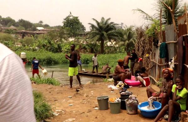 Women washing, woman returning, lady fetching water