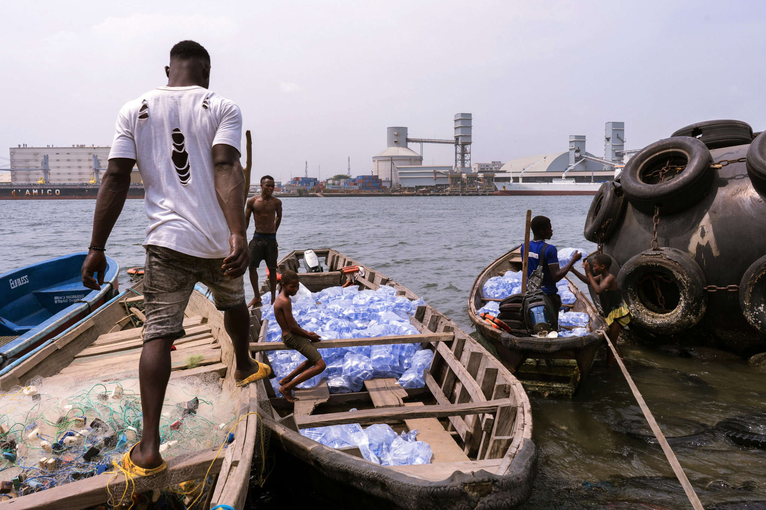 Sagbo Kodji shops bring in pure water in plastic bags from mainland Lagos, and then often employ children to carry them to their shops. [PHOTO CREDIT: Nengi Nelson]