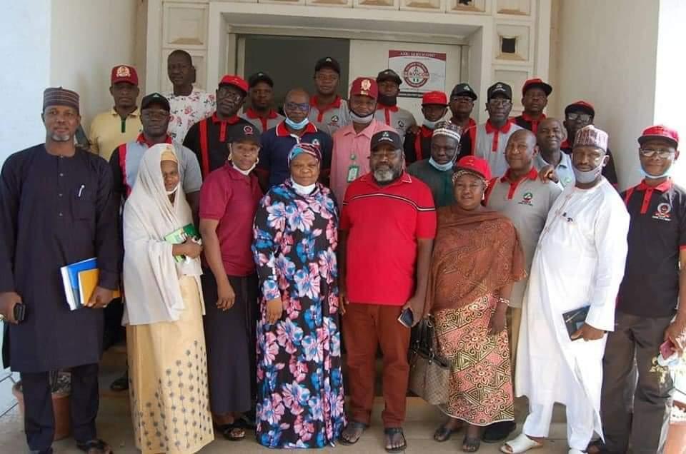 Baraatu Mohammed, HOS, with TUC members in Kaduna on Monday.