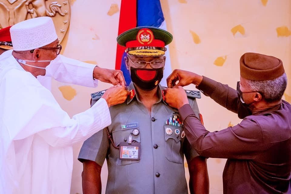 President Muhammadu Buhari decorates Army Chief, Faruk Yahaya as Lieutenant General [PHOTO CREDIT: Femi Adesina]