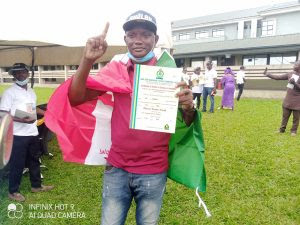 PDP Councillor-elect, Adesola Thomas, displaying his Certificate of Return