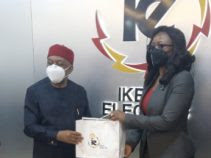 Mrs Soetan presenting a souvenir to Theodore Orji, Chairman, Senate Committee on Privatisation and Commercialisation during the committee's visit to Ikeja Electric on Thursday.