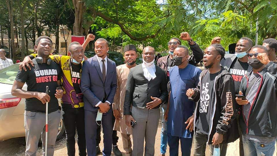The 'Buhari-Must-Go' protesters with their lawyer, Tope Temokun; Sahara Reporters publisher, Omoyele Sowore, and other supporters at the Wuse Zone 2 Magistrates' Court in Abuja on Monday. (Photo Credit: Tope Temokun's Official Facebook Handle)