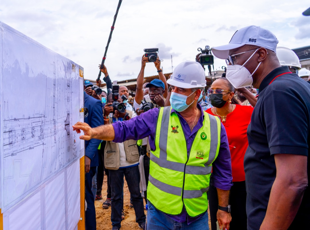 Senior Project Manager, Craneburg Construction Company, Mr. Nicolas Mfarrej (left) taking Lagos State Governor, Mr. Babajide Sanwo-Olu through a plan of the Lagos Rail Mass Transit Red Line Project at Yaba, during an inspection on Saturday, September 25, 2021.