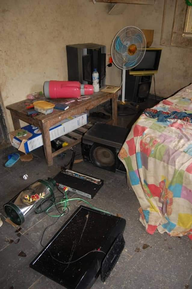 Vandalised television set and other items in Mr George's home